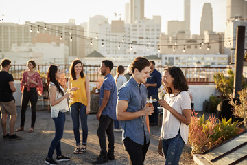 Friends Gathered On Rooftop Terrace For Party With City Skyline In Background Fototapete