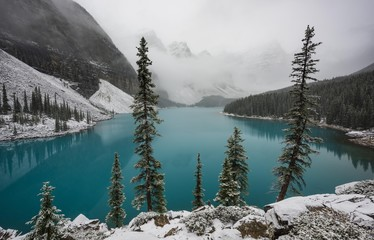 Turquoise Moraine Lake, first snowfall in autumn, Valley of the Ten Peaks, Banff National Park Rocky Mountains, Alberta, Canada, North America