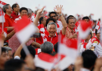 Singapore's Prime Minister Lee Hsien Loong arrives for the National Day parade along Marina Bay in Singapore
