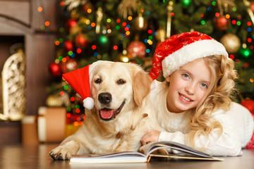 Blonde girl with golden retriever, christmas
