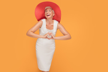 Middle age smiling woman in red summer hat.