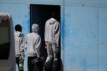 Migrants enter to the new Center for Temporary Assistance to Foreigners after arriving at the port of Algeciras in San Roque