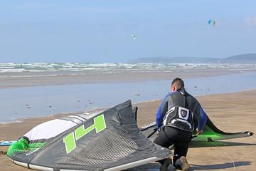kitesurfer preparing his kite