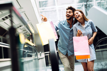 Happy attractive loving couple enjoy shopping together