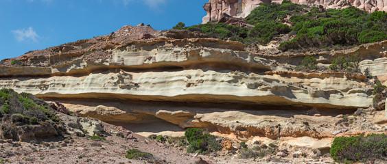 Sedimentary rock stratifications in the island of San Pietro, in Sardinia, Italy.