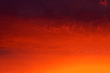 Foto op Canvas Rood traf. The sky with clouds painted with the setting sun