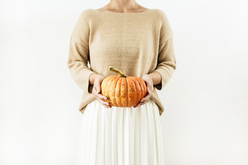 Young woman hold halloween pumpkin. Fall autumn concept.
