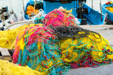 Colorful fishnet in a boat in the port Heraklion on the dusk. Island of Crete, Greece