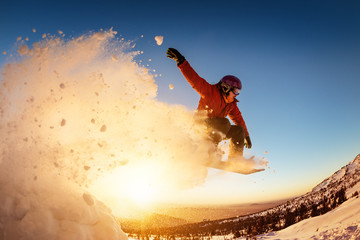 Foto auf Acrylglas Wintersport Snowboarder jumps sunset with snow dust