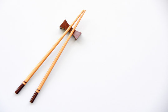 wood Chopsticks on White background Copy space.