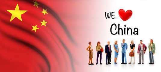 we love China, A group of people pose next to the Chinese flag