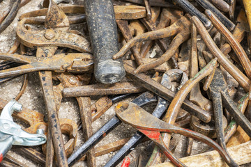 Disorderly scattered various pliers, hand tool texture background