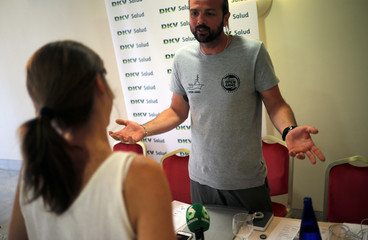 Missions coordinator of the NGO Proactiva Open Arms Gerard Canals gestures as he talks with a journalist after a news conference of members of the NGO after they arrived on the Open Arms rescue boat with migrants rescued in central Medi