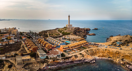 Lighthouse of Cabo de Palos, cape in the Spanish municipality of Cartagena, in the region of Murcia. Small spanish village, drone arial panoramic photo. Summer 2018 from drone