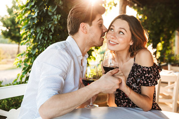Loving couple sitting in cafe by dating