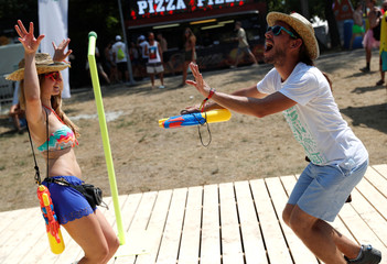 Festivalgoers dance during the Sziget music festival on an island in Budapest