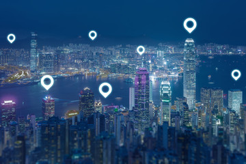 Check in concept for travel with pin graphic on Hong Kong skyscraper at night.