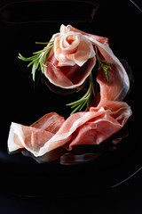 Fototapete - Prosciutto with rosemary.