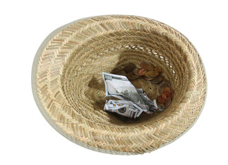 Straw hat and money with playing cards on a white background