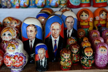 Souvenirs-matryoshka dolls with the image of Russian President Vladimir Putin on the counter of Souvenirs in Moscow