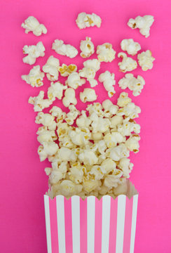 Popcorn Exploding out of Pink Striped Box