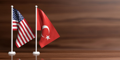 US of America and Turkey miniature flags on wooden background, copy space. 3d illustration