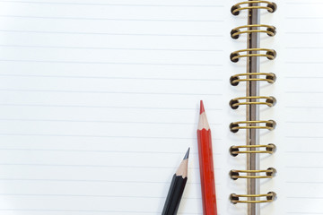 Close up memo notebook paper and pencil