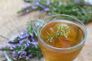 Cup of  fresh natural tea on wooden table.  Thymus serpyllum natural tea, Breckland Thyme  with cup of tea