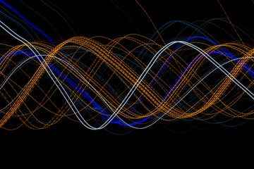 Colorful light painting with circular shapes and abstract black background.