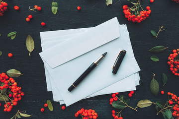 Flat lay blank envelope and pen mock up copy space