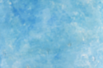 Blurred blue pastel color wall vignette texture abstract background.