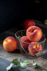 farm fresh peaches on rustic table