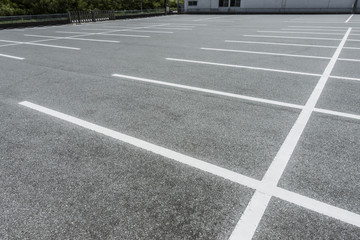 Car Parking lot with parking barrier, Vacant Parking Lot, Parking lane painting on floor, copy space