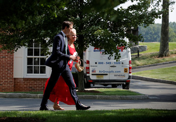 White House Senior advisor Kushner and White House counselor Conway walk outside before participating in a roundtable discussion with state leaders on prison reform in Berkeley Heights, New Jersey