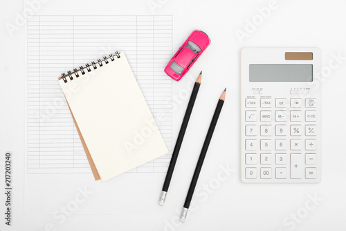 car expenses calculator payments costs with paper notes pencil