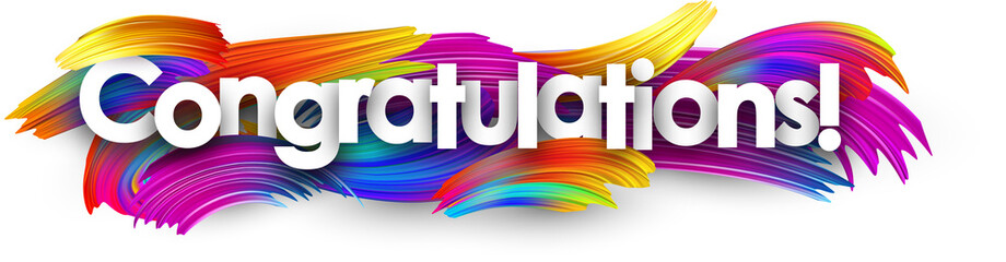 Congratulations paper banner with colorful brush strokes.