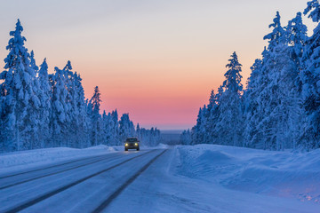 Evening on the winter road in Finland