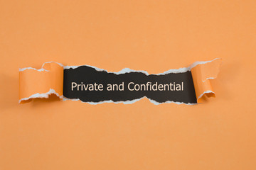 The word Private and confidential appearing behind torn paper.