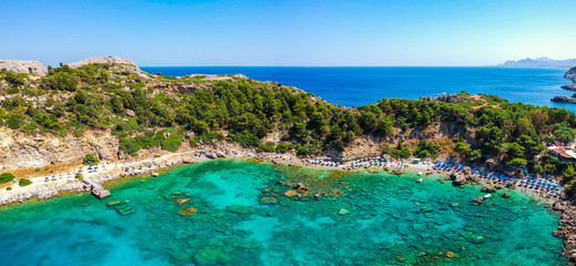 Aerial birds eye view drone photo Anthony Quinn and Ladiko bay on Rhodes island, Dodecanese, Greece. Panorama with nice lagoon and clear blue water. Famous tourist destination in South Europe Fototapete