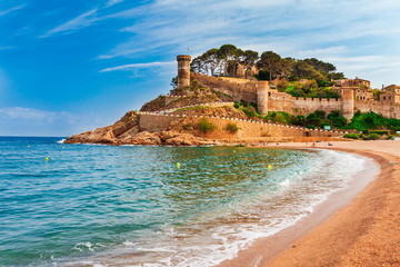 Sea landscape Badia bay in Tossa de Mar in Girona, Catalonia, Spain near of Barcelona. Ancient medieval castle with nice sand beach and clear blue water. Famous tourist destination in Costa Brava Wall mural