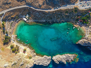 Aerial birds eye view drone photo Saint Paul bay near village Lindos, Rhodes island, Dodecanese, Greece. Sunny panorama with lagoon and clear blue water. Famous tourist destination in South Europe