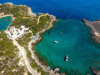 Aerial birds eye view drone photo Ladiko bay and Anthony Quinn on Rhodes island, Dodecanese, Greece. Panorama with nice lagoon and clear blue water. Famous tourist destination in South Europe