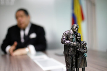A statue of Venezuela's late President Chavez is seen at the office of National Constituent Assembly member Escarra in Caracas