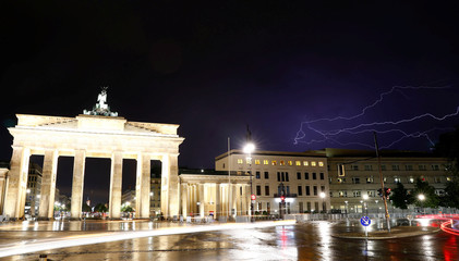 Thunderbolts are seen over the U.S. Embassy next to the Brandenburg Gate in Berlin