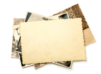 Stack old photos isolated on white background. Mock-up blank paper. Postcard rumpled and dirty vintage