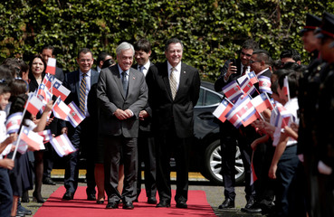Chile's President Sebastian Pinera  walks next to his Minister of Foreign Affairs Roberto Ampuero, during a welcoming ceremony at the Presidential house in San Jose