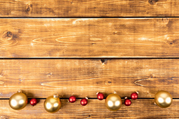 red and gold christmas balls on a wooden background