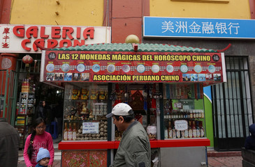 People walk at Chinatown in Lima