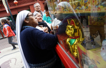 Women observe products at Chinatown in Lima