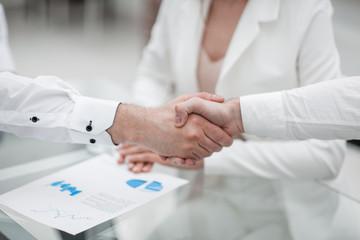 close up. handshake financial partners at the negotiating table
